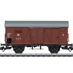 TRIX 25301 - KOMIS. Wagon towarowy kryty serii G, z rozsuwanymi drzwiami, DR, ep.III, skala H0.